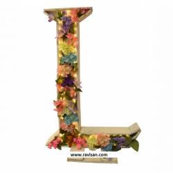 Letra con flores y luz
